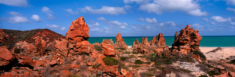 Pinnacles of sandstone like turrets of a lost city over looking the ocean.
