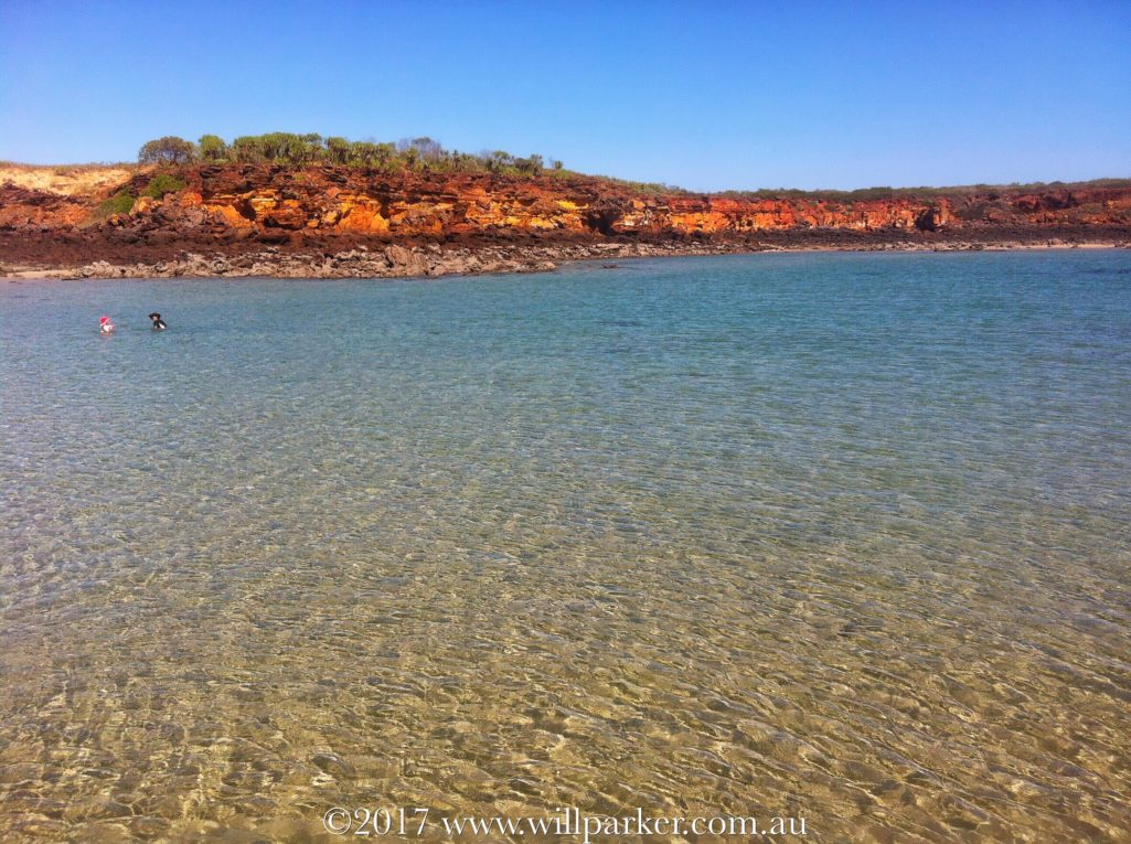 My two intrepid travellers - explores doing what they love. Exploring a remote Kimberley beach.